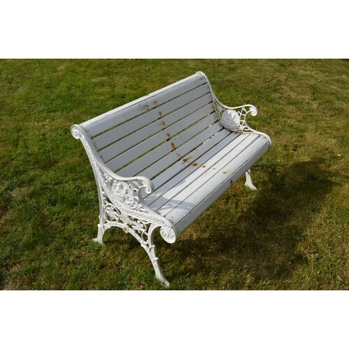 Two seater garden bench with cast iron ends and wooden slats...