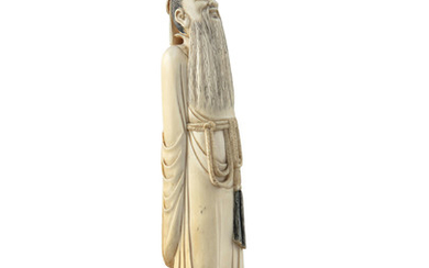 A CHINESE CARVED IVORY FIGURE...