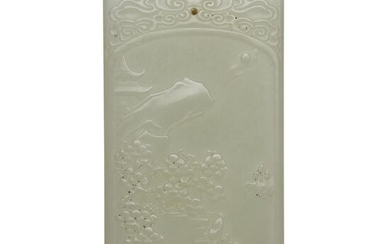 A Chinese carved white jade pendant 20th century One...