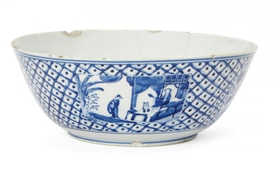 A Chinese porcelain punch bowl, 18th century, painted in underglaze...