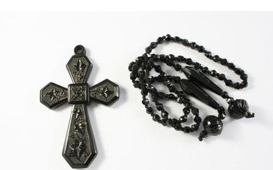 A JET CRUCIFORM PENDANT AND NECKLACE the pendant embossed wi...