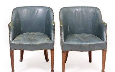 A PAIR OF BLUE LEATHER UPHOLSTERED SIDE CHAIRS with...