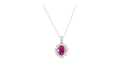 A PINK TOURMALINE AND DIAMOND CLUSTER PENDANT, the oval tour...