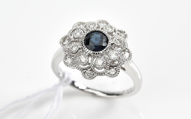 A SAPPHIRE AND DIAMOND RING IN 18CT WHITE GOLD, SAPPHIRE OF 0.75CTS, APPROXIMATE TOTAL DIAMOND WEIGHT 0.26CTS