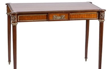 A bronze-mounted parquetry bureau in Louis XVI style...