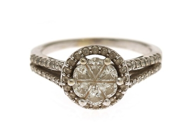 A diamond ring set with numerous fancy- and brilliant-cut diamonds, mounted in 14k white gold. Size 48.5.