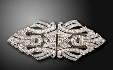A diamond-set double clip brooch, set with graduated old circular, baguette and square-shaped diamonds in a lozenge-shaped openwork platinum mount, each clip 3.6cm wide, brooch 7.2cm wide