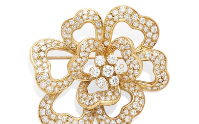 A gold and diamond floral brooch