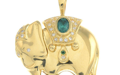 A green paste and diamond elephant pendant.
