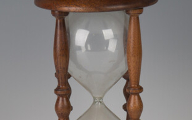 A late 20th century mahogany framed hour glass, height 26cm.