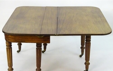 A mid 19thC mahogany extending dining table with a concertin...