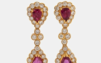 A pair of 18K gold earrings set with faceted rubies and round brilliant-cut diamonds