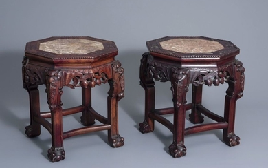 A pair of Chinese carved wood stands with...