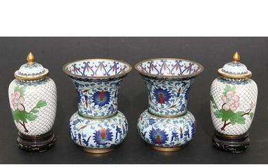 A pair of Chinese cloisonne vases decorated with flowers on ...