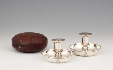 A pair of Vienna silver travel candlesticks in a fitted case