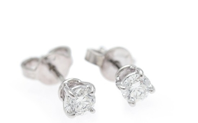 A pair of diamond ear studs each set with a brilliant-cut diamond weighing a total of app. 0.53 ct., mounted in 18k white gold. TW-W/VS-SI. (2)