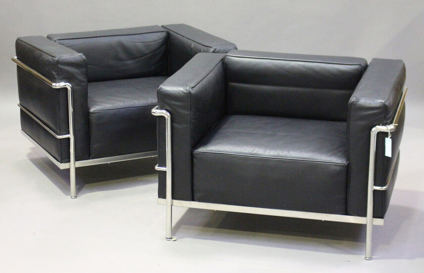 A pair of modern LC2 style armchairs, after a design by Le Corbusier, the black leather cushions sup