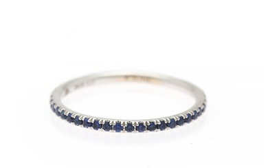 A sapphire and diamond ring set with numerous sapphires and a brilliant-cut diamonds, mounted in 18k rhodium plated gold. Size 54.