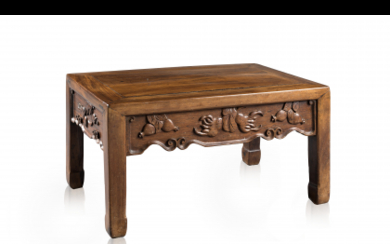 A side table decorated with auspicious fruits carved to...