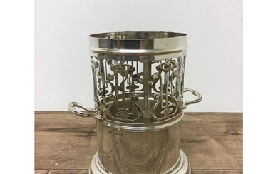 A sterling silver arts and crafts style wine cooler with tur...