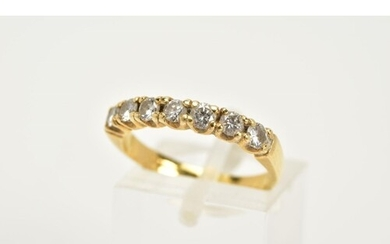 AN 18CT GOLD DIAMOND HALF ETERNITY RING, designed with seven...