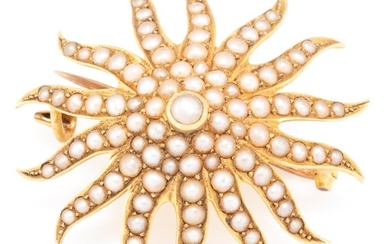 AN ANTIQUE 15CT GOLD STARBURST PEARL BROOCH; set with seed pearls, with Birmingham import hallmarks for 1906, N.H, with hook for ext...