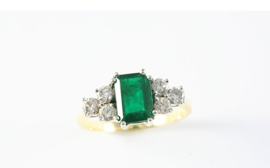 AN EMERALD AND DIAMOND RING the rectangular-shaped emerald i...