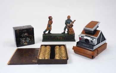 An American cast iron 'Hometown Battery' money bank, late 19th...