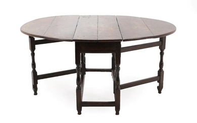 An Early 18th Century Six-Seater Oak Gateleg Table, with two...
