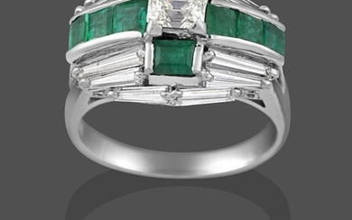 An Emerald and Diamond Cluster Ring, a cross motif formed...