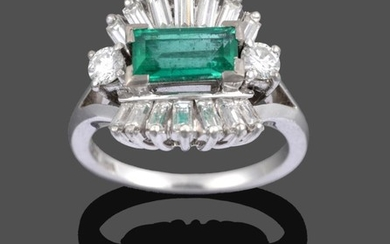 An Emerald and Diamond Cluster Ring, the central step cut...