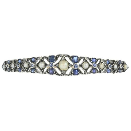 An early 20th century silver and gold, sapphire, split