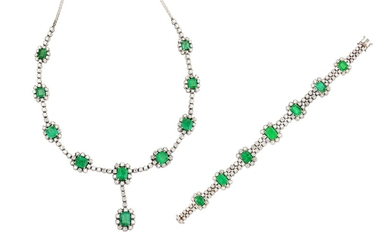 An emerald and diamond pendant necklace and bracelet suite