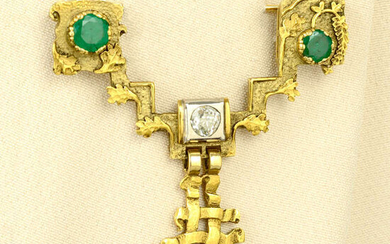 An emerald and old-cut diamond brooch.