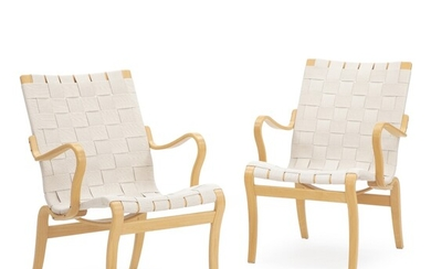 """Bruno Mathsson: """"Mina"""". A pair of easy chairs of molded beech. Seat and back with..."""