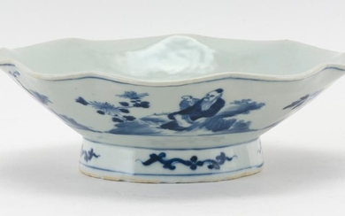 CHINESE BLUE AND WHITE PORCELAIN FOOTED BOWL With a shaped petal age and exterior decoration of figures in a landscape. Six-characte...