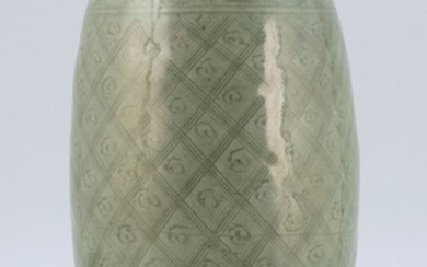 """CHINESE LONGQUAN CELADON PORCELAIN VASE In seed form, with a diapered pattern to body. Height 14"""". Provenance: A private Florida Col..."""