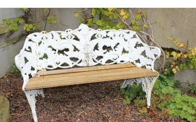 Cast iron garden bench with fern decoration on back and slat...