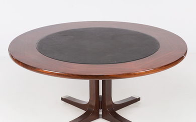 Circular dining table in rosewood and centrepiece in imitation leather, circa 1970.