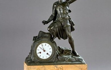 Clock in bronze and yellow marble from Siena with a fisherman's cushion decoration, rectangular base with a doucine decorated with acanthus leaves and finished with bronze feet.