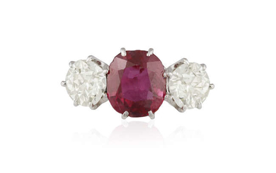 Description A RUBY AND DIAMOND THREE-STONE RING The cushion-shaped...
