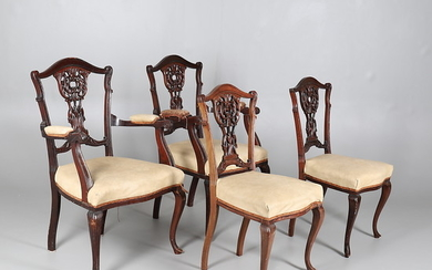 FOUR LATE VICTORIAN MAHOGANY FRAMED CHAIRS IN THE ROCOCCO STYLE.