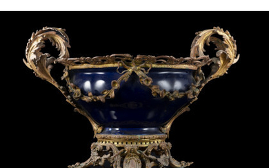 French manufacture, 19th century. A porcelain vase mounted on bronze...