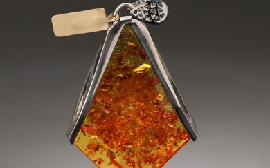 House of Amber. Cognac amber and sterling silver pendant. 64.6 g.