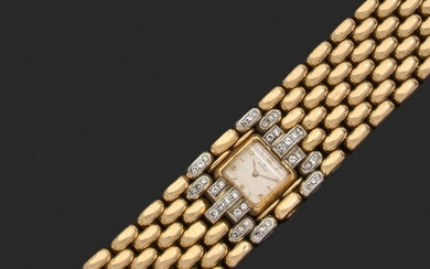 Large ARTICULATED ribbon BRACELET in gold and platinum, adorned at the centre with a square bracelet watch with mechanical movement in attachments set with brilliants and diamonds eight-eight. The monogrammed clasp. The dial, the watch plate and the...