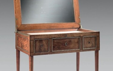 Mahogany men's hairdresser with brass moldings. Ice-bottomed tray...
