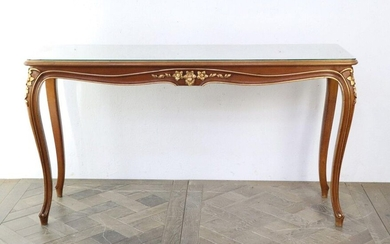Narrow console in carved and molded wood, partially gilded, the top painted with a gold cartouche.