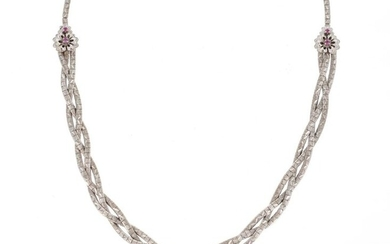Necklace in 18 K (750 °/°°°) white gold made of a guilloche and braided mesh on three rows, the fasteners set with small treated rubies.