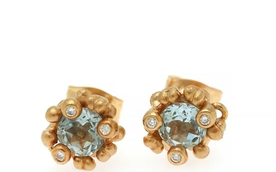 "Ole Lynggaard: A pair of ""Flower Basket"" diamond and aquamarine ear studs each set with an aquamarine and three diamonds, mounted in 18k gold. (2)"