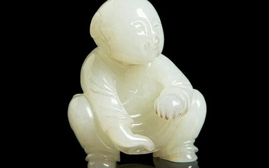 PALE CELADON JADE CARVING OF A SQUATTED BOY QING